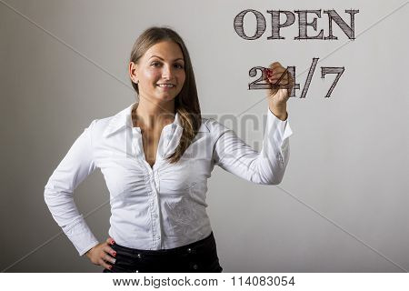 Open 24/7 - Beautiful Girl Writing On Transparent Surface