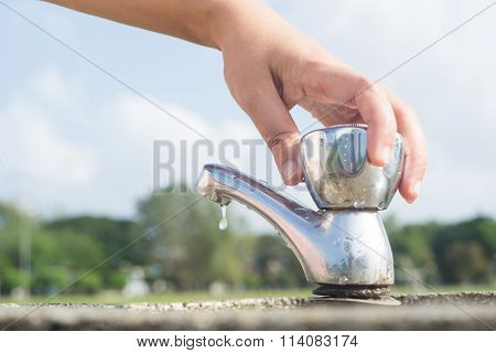 Woman Hand Shut The Faucet.