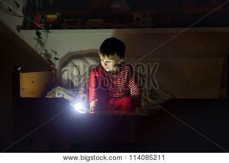 Cute Little Caucasian Child, Boy, Reading Book In Bed