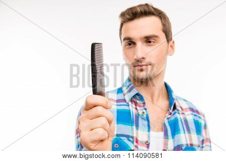 Handsome Man Holding A Comb