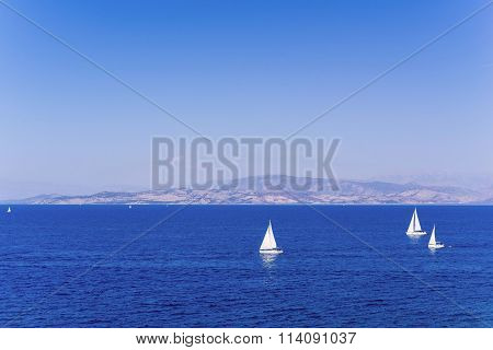 Sea Landscape With Yachts And A Massif On The Horizon