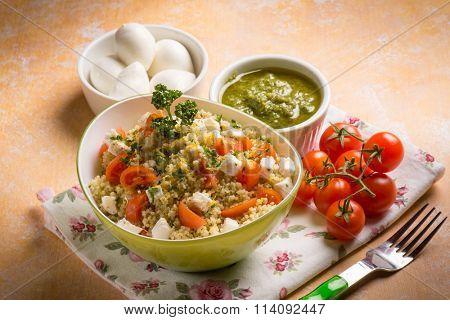 vegetarian couscous with mozzarella tomatoes and pesto sauce