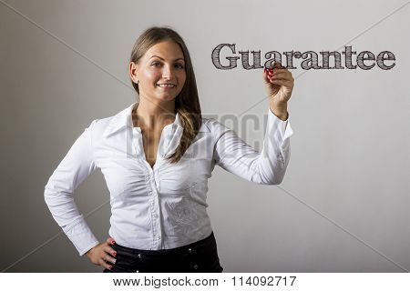Guarantee - Beautiful Girl Writing On Transparent Surface