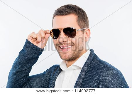 Close Up Photo Of Young Man Touching His Spectacles