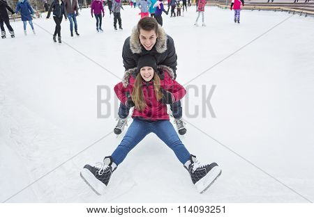 Ice skating couple having winter fun on ice skates Quebec, Canada.
