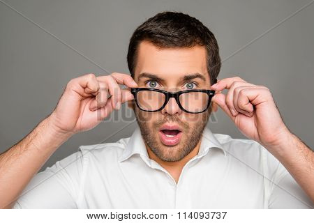 Surprised Man Touching Glasses