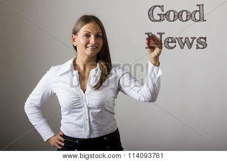 Good News - Beautiful Girl Writing On Transparent Surface