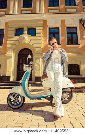 Pretty Man With Bike Holding Phone And Smoking