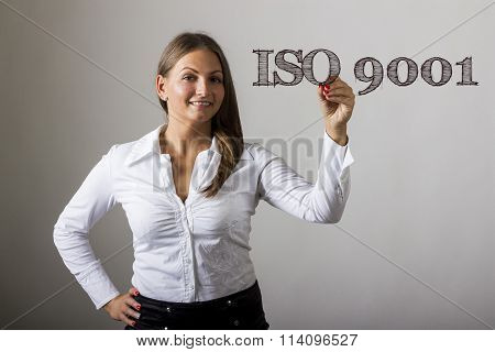 Iso 9001 - Beautiful Girl Writing On Transparent Surface