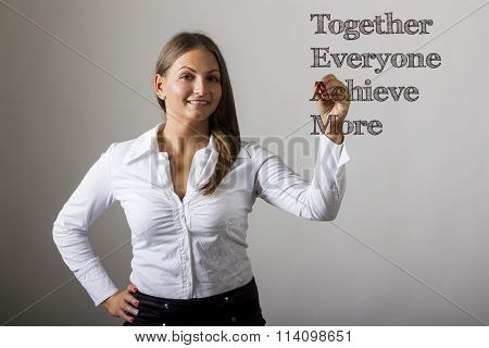 Together Everyone Achieve More Team - Beautiful Girl Writing On Transparent Surface