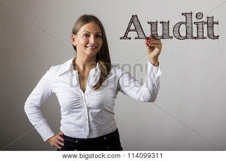 Audit - Beautiful Girl Writing On Transparent Surface