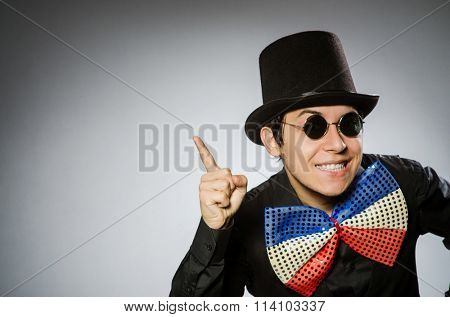 Funny man with sunglasses and vintage hat