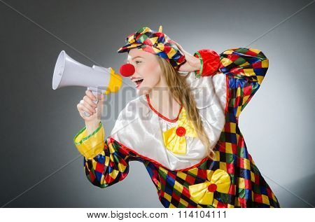 Clown with loudspeaker isolated on white