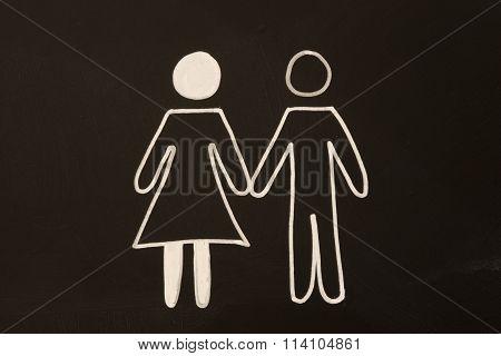 happy couple on blackboard