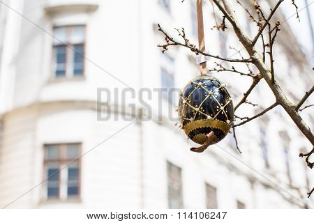 Black and gold painted Easter egg on the tree