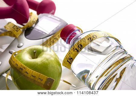 Scale With Dumbbells Bottle Apple And Tape Measure Elevated View