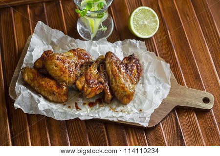 Spicy Baked Chicken Wings On Wooden Rustic Table