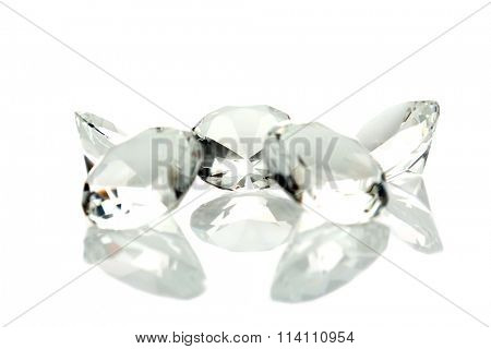 The Mother of All Diamonds and Baby Diamonds isolated on white with reflections. Isolated on white with room for your text. Diamonds are a girls best friend. Shine bright like a diamond.