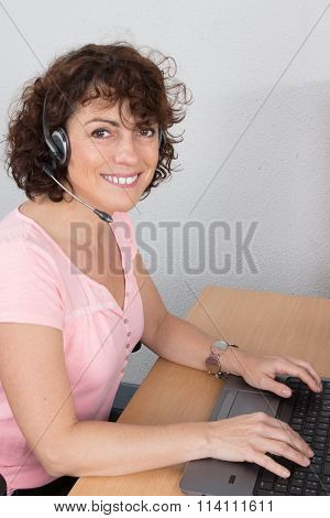 Portrait Of Happy Smiling Cheerful Support Phone Operator In Headset At Office