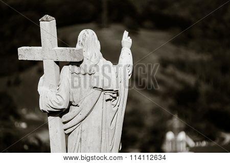 Majestic Jesus Christ Sculpture Over Little French Village