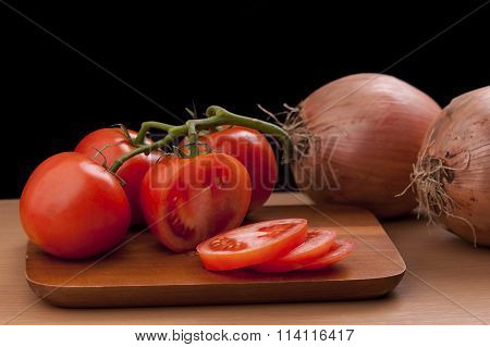 Whole And Sliced Tomatoes.