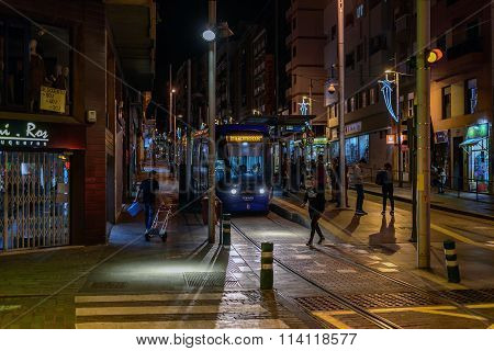 People waiting for tram at night street of Santa Cruz de Tenerife