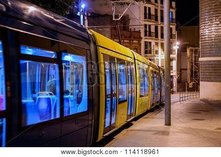 Tram in a night street of old town in Santa Cruz de Tenerife
