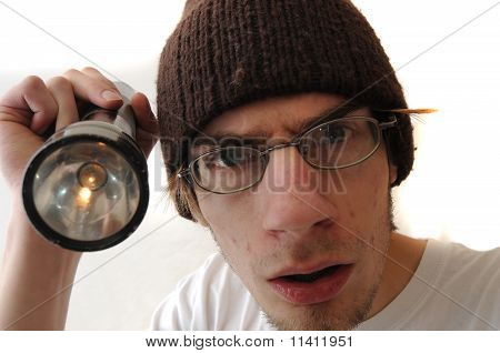 Young Man Holding Flash Light