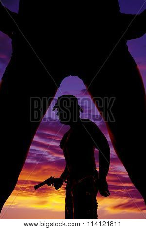 Silhouette Of Cowboy With Gun Between Legs Of Woman