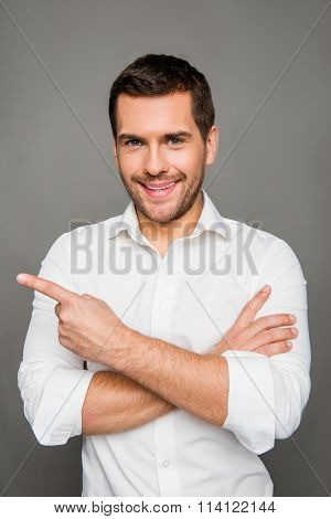 Close Up Photo Of Smaling Man Gesturing With Crossed Hands