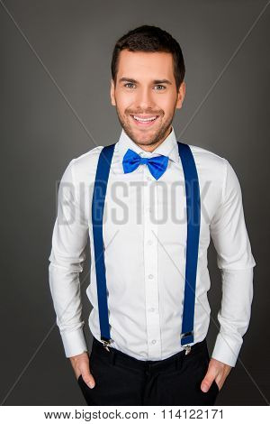 Portrait Of A Young Sexy Man With Beaming Smile And Bow-tie