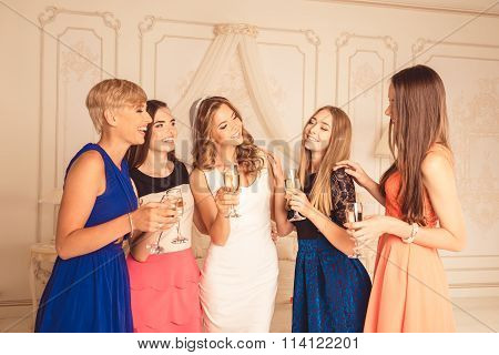 Cheerful Attractive Cute Girls Celebrate A Bachelorette Party Of Bride With Champagne