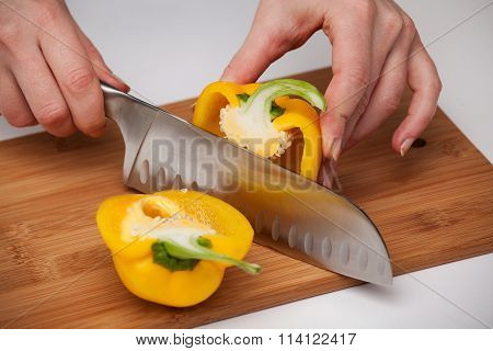 Cutting The Vegetables With A Kitchen Knife On The Board