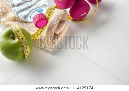 Dumbbells With Apple Bottle And Tape Measure And Towel Elevated