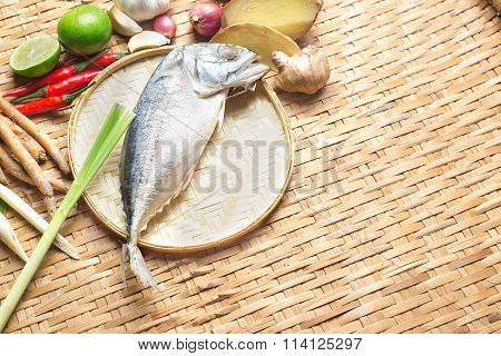 Thai Food Ingredient Of Tom Yum Spicy Soup With Steamed Mackerel Fish On Wooden Texture