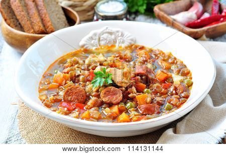 Lentil soup with chicken and pepperoni sausage, onion, carrot, sweet pepper, garlic and parsley.