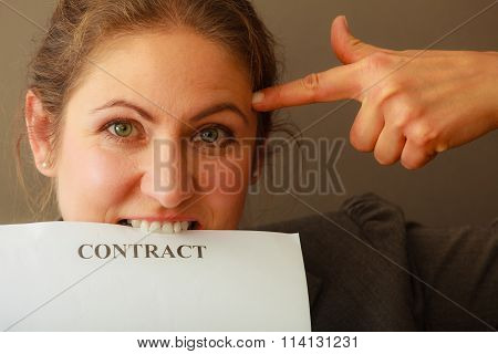 Stressed Business Woman Biting Contract