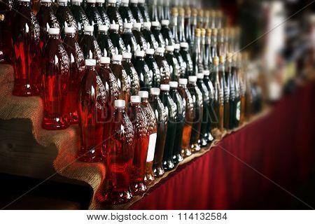 Red wine in bottles arranged in rows