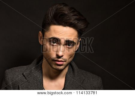 Model man isolated on black background