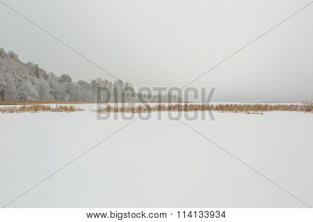 Landscape Of Frozen Lake Covered By Snow