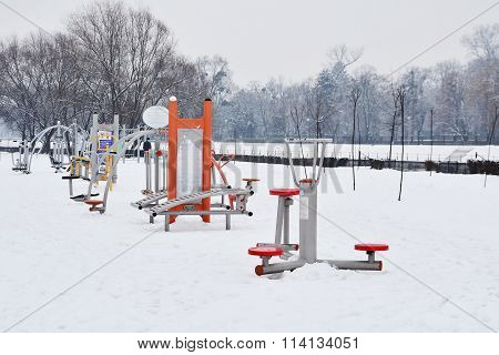 Empty Fitness Equipment Outdoors In The Snow