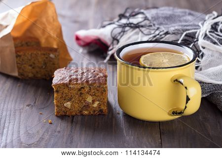 Homemade Carrot And Banana Cake With Nuts, Spices And A Cup Of Tea With Lemon