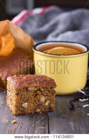 Homemade Carrot And Banana Cake, A Cup Of Tea With Lemon