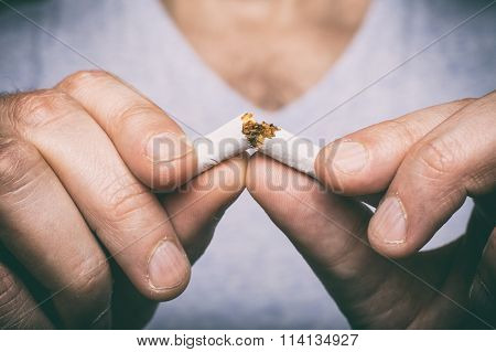 Quitting Smoking - Male Hand Crushing Cigarette