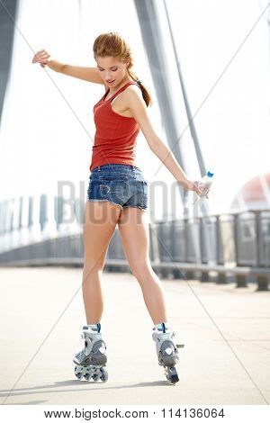 woman skating with rollerblades in a park