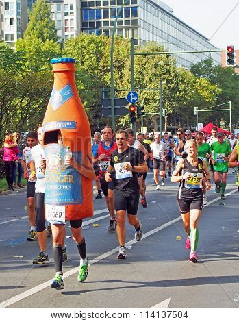runners and a bottle at Berlin Marathon 2014
