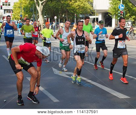 runners at Berlin Marathon 2014, one of them standing