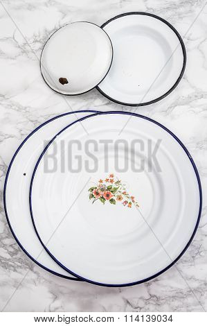Empty White Vintage Enamel Plates With Flower Design