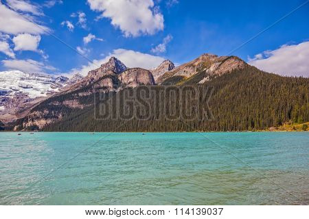 Banff National Park, Canada, Alberta. Magnificent Lake Louise with emerald green water surrounded by the Rocky Mountains, pine forests and glaciers