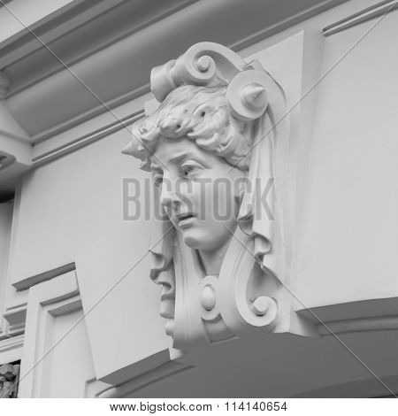 decorative statue of a woman on facade